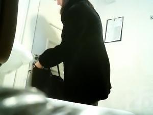 Amateur brunette with a marvelous ass pisses on hidden cam